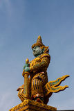 Giant guardian statue at the Temple of Wat Phasrisanpet, Ayuttay. A, Thailand with blue background Stock Image