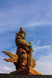 Giant guardian statue at the Temple of Wat Phasrisanpet, Ayuttay. A, Thailand with blue sky Stock Photos