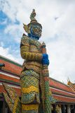 Giant guardian statue at Wat Phra Kaew the Grand Palace in Bangk stock photography