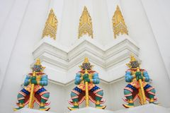 Giant guardians on base of pagoda, Thailand Stock Image