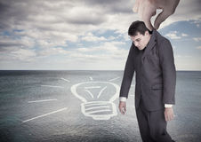 Giant hand dropping off a businessman on a surface Royalty Free Stock Photography