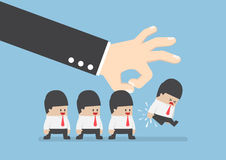 Giant hand flick businessman away Royalty Free Stock Images