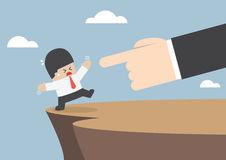 Giant hands push businessman and make him fall from cliff Stock Photo