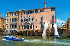 Giant hands rise from the Grand Canal in Venice Royalty Free Stock Photography