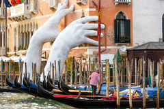 Giant hands rise from the Grand Canal, Venice Stock Images