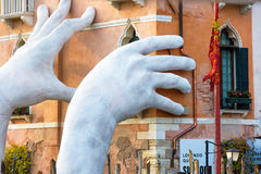 Giant hands rise from the Grand Canal, Venice Stock Photos