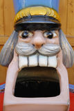 Giant head of nutcracker figure / sculpture with wide open mouth. Closeup of screaming nutcracker figure / sculpture (head) with wide open mouth, big teeth and a Royalty Free Stock Images