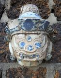 Giant head sculpture decorate by pieces of colorful Chinese porcelain Royalty Free Stock Photo