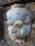 Giant head sculpture small decorate by pieces of colorful Chinese porcelain Stock Photography