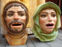 Giant Heads. These papier mâché heads are made to a grand scale, and donned by the street entertainers, while they dance around to entertain the fair goers Stock Photos