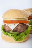Giant homemade burger classic american cheeseburger isolated on Stock Photo