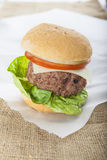 Giant homemade burger classic american cheeseburger on sack Royalty Free Stock Images