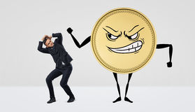 A giant humanoid coin with an angry face beating at a small businessman. Stock Photography