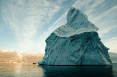 Giant Iceberg with Inflatable Boat Scale - Greenland Stock Photo