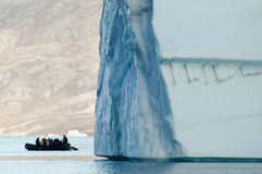 Giant Iceberg with Inflatable Boat Scale Royalty Free Stock Image
