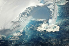 Giant iceberg in the southern ocean. Aqua waves wash over a giant iceberg in the southern ocean as it floats into New Zealand waters, global warming is blamed Royalty Free Stock Photos