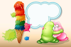 A giant icecream beside the two monsters hugging Royalty Free Stock Image