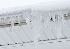 Giant Icicles hang from roof Royalty Free Stock Photo
