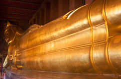 Giant image of reclining Buddha Royalty Free Stock Image