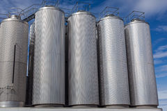 Giant industrial tanks on the bright blue sky Royalty Free Stock Images