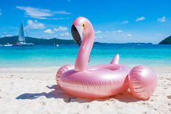 Giant inflatable pink flamingo pool float toy on the tropical be. Ach, sea royalty free stock photos