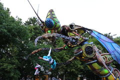 Giant insect and acrobats Stock Images