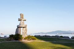 Vancouver`s Giant Inukshuk. The giant Inukshuk at English Bay in Vancouver royalty free stock images
