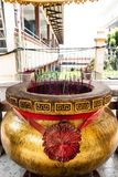 Giant joss stick pot with red incense stick at Chinese temple stock images