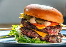 Giant juicy double burger, closeup royalty free stock images