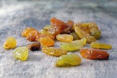 Giant juicy raisins on wood Royalty Free Stock Photo