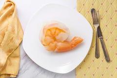 Jumbo Shrimp Oxymoron. Giant jumbo shrimp on plate depicting the literary term oxymoron royalty free stock photography