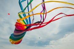 Giant kite. Rainbow giant kite big fly colorful stock photos