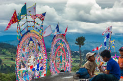 Giant kites in cemetery, All Saints' Day, Guatemala. Santiago Sacatepequez, Guatemala - November 1, 2006: Locals display huge circular kites called barriletes Stock Images