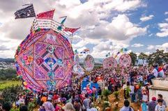 Giant kites & crowded cemetery, All Saints' Day, Guatemala. Santiago Sacatepequez, Guatemala - November 1, 2010: Giant kites in crowded cemetery depicting Royalty Free Stock Photos