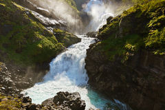 Giant Kjosfossen waterfall in Flam - Norway Royalty Free Stock Images
