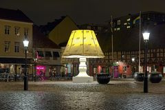 The Giant Lamp on the Lilla Torg Square of Malmo, Sweden. The Giant Lamp on the Lilla Torg Square of Malmo in night, Sweden. Throughout the year the lamp with Royalty Free Stock Photo