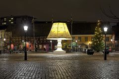 Giant Lamp on the Lilla Torg Square of Malmo, Sweden. The Giant Lamp on the Lilla Torg Square of Malmo, Sweden. Throughout the year the lamp with height of 5.8 m Stock Images