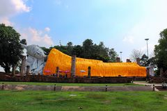 Giant Laying Down Buddha in Ang Thong, Thailand. A giant Buddha lays down in Ang Thong, Thailand. This is one of the biggest Buddhas in Southeast Asia. Its Stock Photo