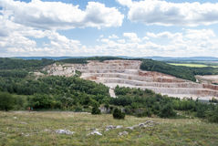 Giant limestone quarry with blue sky and clouds Royalty Free Stock Image