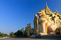 Giant lions at Shwedagon Pagoda entrance at Yangon Royalty Free Stock Photo