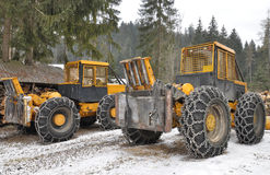 Giant logging vehicles in the winter forest Royalty Free Stock Photography