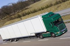 Giant lorry, truck. Large lorry, truck, green and white on motorway Royalty Free Stock Photo