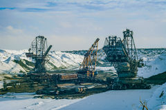Giant machines in quarry. Open development. Huge machines manganese ore is mined in open pits. Metallurgical industry in Ukraine Royalty Free Stock Images