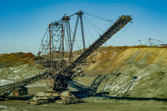Giant machines in quarry - spreader. Royalty Free Stock Photo
