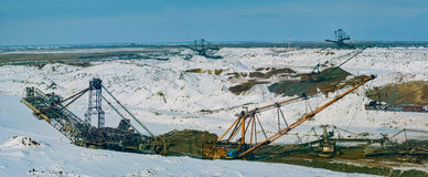 Giant machines in quarry - walking excavators and bucket wheel excavator. Royalty Free Stock Photography
