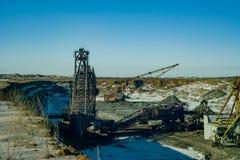 Giant machines in quarry - walking excavators and bucket wheel excavator. Stock Photos
