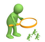 Giant with a magnifier and small people Stock Image