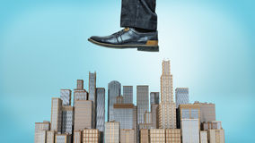 A giant male shoe ready to stomp at a small cluster of business towers on blue background. Business and competition. Fight for the big clients. International Royalty Free Stock Image