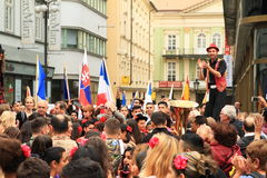 Giant man in Khamore - world roma festival. Gypsies - dancing giant gypsy man and other people playing music instruments and holding flags on Wenceslas Square stock photos