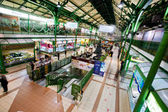 Giant market hall with many small shops Royalty Free Stock Photography